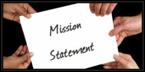hands holding paper stating 'mission statement'  style=