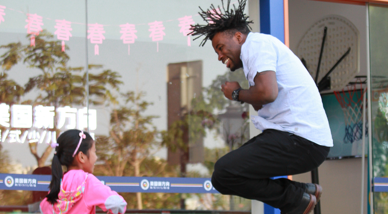 Girl in China and Jerome Moore jumping