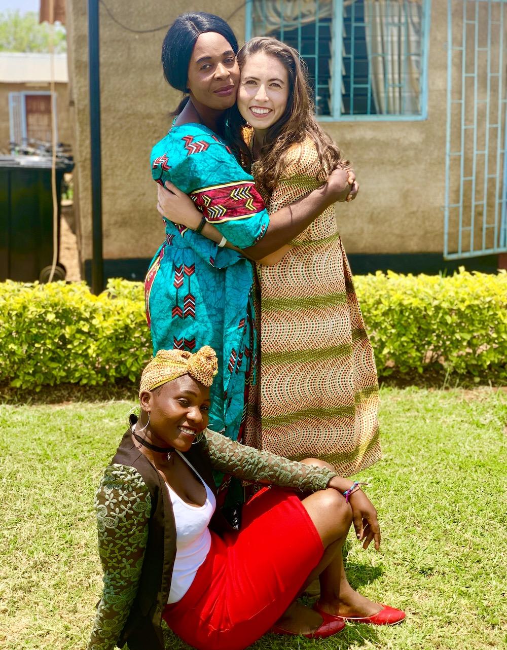 Silvia Mwape with Volunteer Milana Baish. Seated: Abigail Shamz