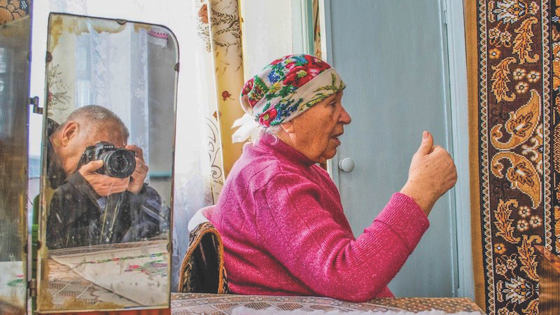 Ukrainian grandmother in village, photographed in profile