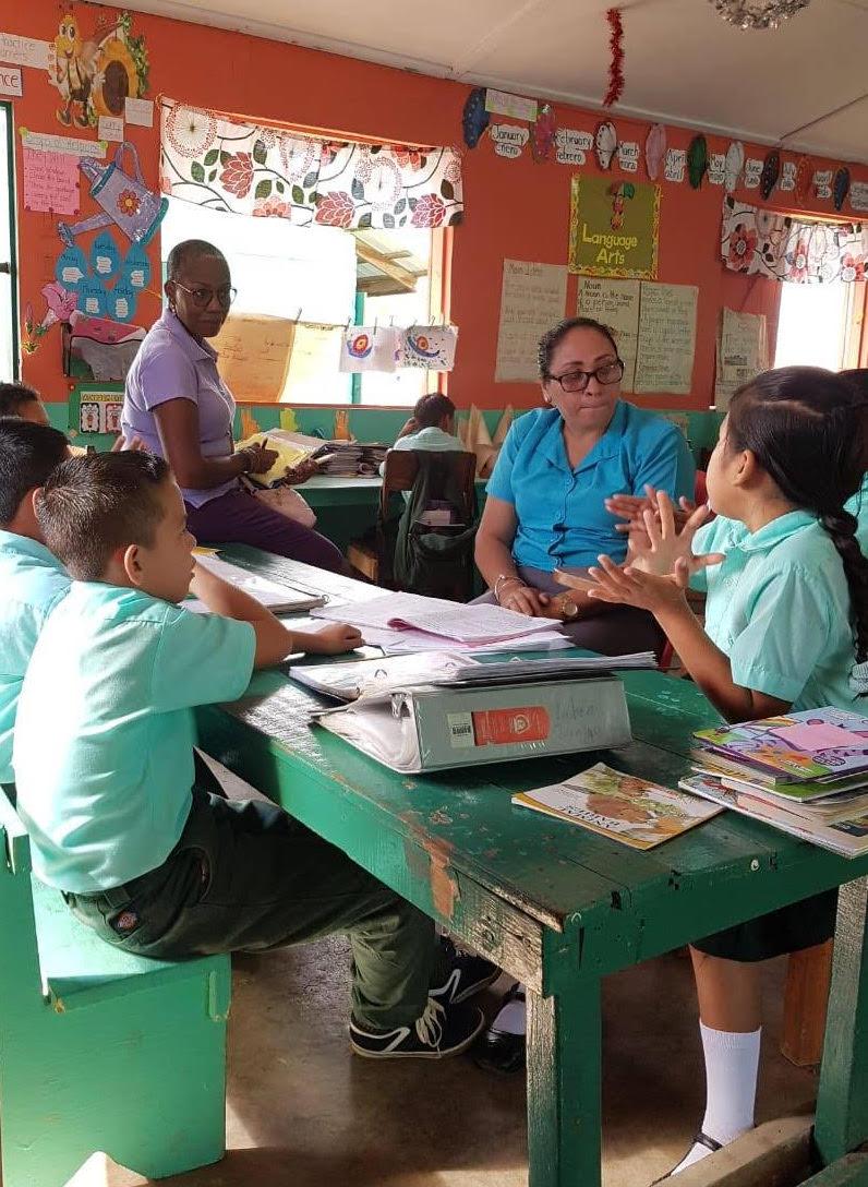 Judith Jones watching teacher and students in Belize
