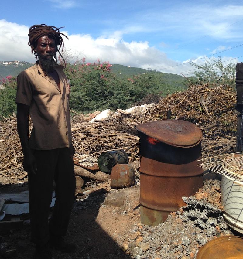 Rastafarian artist at dump in Jamaica