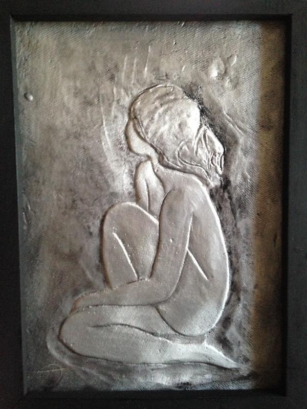 Aluminum relief of woman