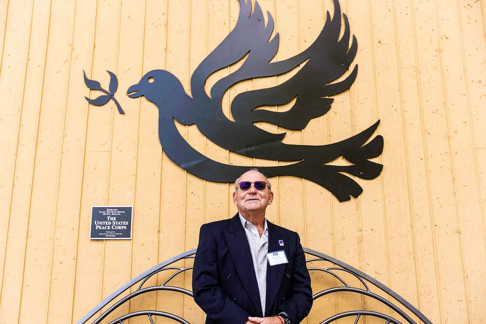 David Garcia with sculpture of dove and bench