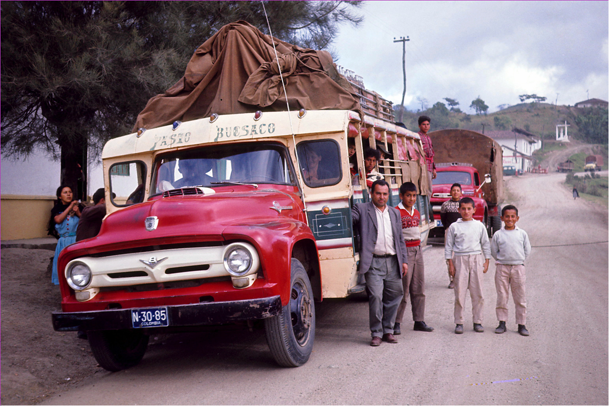 Local bus with owner and sons, Pan American Highway - Narino, Colombia